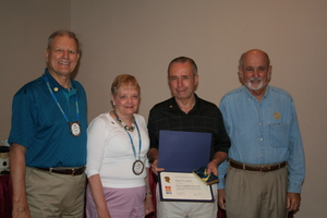 3/20/2013 Paul Slosberg presents a Paul Harris Fellow Award to Roger Carlson